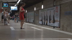 People using public transport, waiting subway in station moving slow on platform Stock Footage