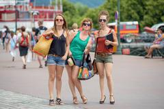 Stock Photo of three young women make tourism