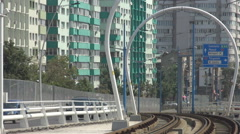 Tram rails view, downtown city streetcar has his own railway cars on road moving Stock Footage