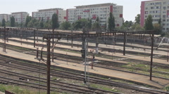 Abandoned railway station, old railways view, rusty electric power poles seen Stock Footage