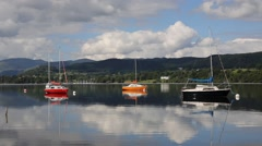 Three colourful boats Ullswater Lake District Stock Footage