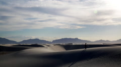 Young woman walking in the desert - stock footage