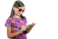 Schoolgirl writing on agenda Stock Photos