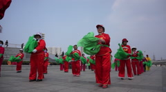 Chinese aunties dancing yangko on a square Stock Footage