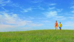 Two happy kids enjoying freedom and childhood, running, together, joy Stock Footage