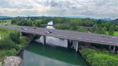 Aerial vehicles driving fast on highway bridge Stock Footage