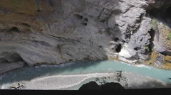 Birds eye dolly shot of liwu river and pothole in rock cliff Stock Footage