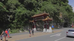 Tourists taking pictures at The taroko gorge front gate Stock Footage