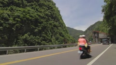 Cars drive by Cimu Bridge(Motherly Devotion Bridge) Stock Footage