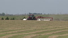 Case Tractor Raking Far Pan Left Stock Footage