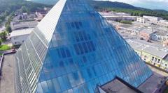 Aerial flight around glass pyramid Stock Footage