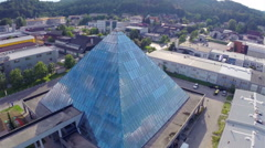 Flight over glass pyramid in Trzin Stock Footage