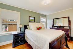 Aqua tone bedroom with wooden furniture Stock Photos