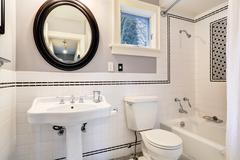 White bathroom with tile wall trim Stock Photos