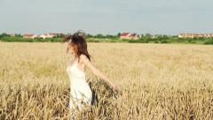 Happy woman turning around cross wheat field super slow motion, 240Fps HD Stock Footage