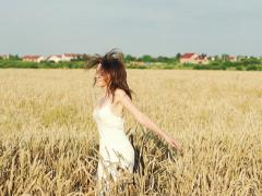 Happy woman turning around cross wheat field super slow motion, 240Fps NTSC Stock Footage