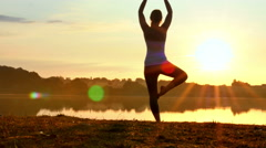 Stock Video Footage of Woman Practising Yoga at Sunrise 4K