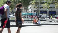 People on city walking and resting, sunny day Stock Footage