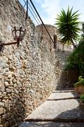 ancient stone paved street - stock photo