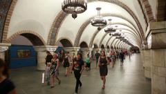 Crowd goes from cars at a metro station in Kiev. - stock footage