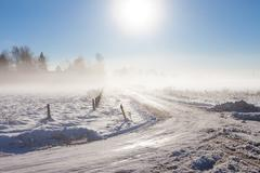 Winter landscape at fog  with road Stock Photos