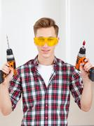 Repairman with a drill and a screwdriver Stock Photos