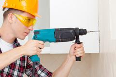 worker with drill - stock photo