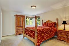 Bedroom with high pole bed and wardrobe Stock Photos