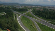Stock Video Footage of AERIAL: Trucks driving on a highway