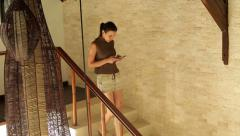 Woman smartphone walk stairs home luxury K HD Stock Footage