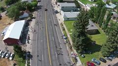 Aerial flight along rural town parade HD 044 Stock Footage
