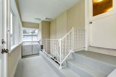 hallway to basement with laundry area - stock photo