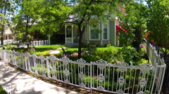 Old Style Wooden House With Porch And Front Yard Flower Garden Stock Footage