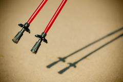 Nordic walking. red sticks on the sandy beach Stock Photos