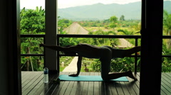 Silhouette of man exercising on terrace of country house HD Stock Footage