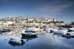 fishing boats moored in brixham harbour, devon - stock photo