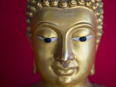 Head of Buddha Statue Over Vibrand, Warm Background Stock Photos