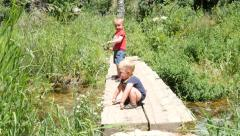 Boys fishing on a bridge. Stock Footage