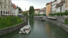Boat with tourists floats on the river Ljubljanica Stock Footage