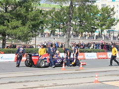 Rider climbs out of a Formula 1 car. G-Drive Show. 640x480 Stock Footage