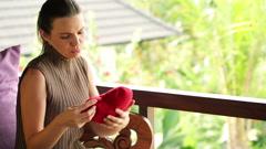 Sad, heart broken beautiful woman, regretting her loss on terrace HD - stock footage