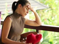 Sad, heart broken beautiful woman, regretting her loss on terrace NTSC - stock footage
