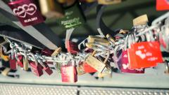 Romantic scenery of locks mounted on bridge wall symbolizing togetherness   Stock Footage