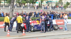 Formula 1 cars are pushing through the city. G-Drive Show Stock Footage