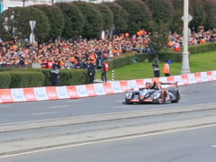 Roman Rusinov rides in the city on prototype team G-Drive Racing. 640x480 Stock Footage