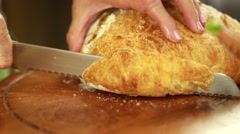Woman slicing fresh artisan bread Stock Footage