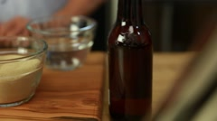 A woman puts yeast in beer bread dough Stock Footage