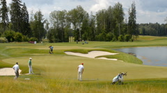 Golfers on the course Stock Footage