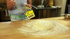 Woman making a fresh loaf of beer bread in the kitchen Stock Footage