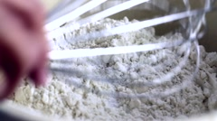 Woman mixing dry ingredients for bread dough Stock Footage
